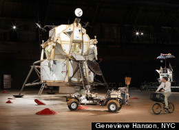 Installation view of the Landing Excursion Module (LEM), Mars Excursion Roving Vehicle (MERV), and Tom Sachs on WAR Bike in