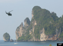 A helicopter delivering supplies leaves Phi Phi Island Tuesday, Dec. 28, 2004, in Thailand. (AP Photo/Suzanne Plunkett)