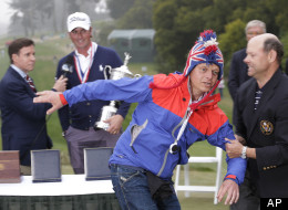 A fans runs in front of Webb Simpson as he is interviewed after the U.S. Open Championship golf tournament Sunday, June 17, 2012, at The Olympic Club in San Francisco.