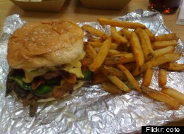 Five Guys has agreed in a lawsuit settlement to give $50 gift certificates to many gift card holders, since the restaurant chain illegally charged a $2 monthly fee to gift cards that were not used for 12 months.