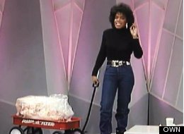 Oprah Winfrey wheels out a wagon of fat on a 1997 episode of