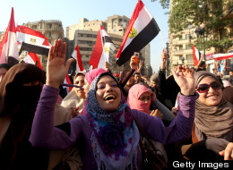 Female Egyptian supporters of new president and Muslim Brotherhood leader Mohamed Morsi wave their national flag as they chant slogans in Cairo's Tahrir Square on Sunday. Tens of thousands packed into Tahrir Square in the largest celebration the protest hub has witnessed since Hosni Mubarak's ouster, to celebrate Morsi winning Egypt's presidential elections.