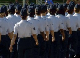 In this June 22, 2012, image made from video, female airmen march during graduation at Lackland Air Force Base in San Antonio. A widening sex scandal has rocked Lackland Air Force Base in Texas, one of the nation's busiest military training centers, where four male instructors are charged with having sex with, and in one case raping, female trainees. (AP Photo/John L. Mone)