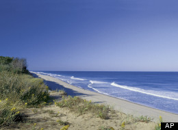 This file photo provided by the Cape Cod Chamber of Commerce shows Coast Guard Beach in Cape Cod, Mass. Beach towns across America are offering great deals on foreclosed properties.