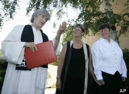 In this June 20, 2008 file photo, the Rev. Jane Spahr, left, a Presbyterian minister, performs a same-sex marriage for Sherrie Holmes, center, and Sara Taylor, at the Marin Civic Center in San Rafael, Calif. The church's highest court later found Spahr guilty of misconduct for officiating the marriage.