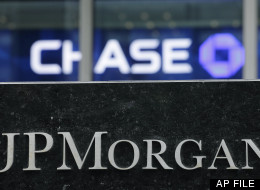 This May 14, 2012, file photo, shows the corporate logos for JPMorgan Chase in New York. (AP Photo/Mark Lennihan, File)