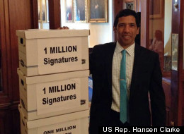 Congressman Clarke stands with over 1 million signatures in support of the Student Loan Forgiveness Act of 2012, which he introduced to the House in March. (U.S. Rep Hansen Clarke)