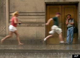 Dave Webber, right, seeks shelter as pedestrians run for cover from the rain as a thunderstorm moves quickly through the Chicago area Friday, June 29, 2012. Most of Illinois is in at least a moderate drought after weeks with little rain. (AP Photo/Sitthixay Ditthavong)