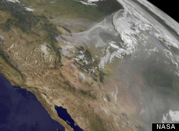 In a June 28 satellite image, smoke from wildfires hangs over North America.