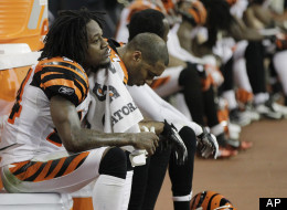 Cincinnati Bengals' Adam Jones (24) and Chris Crocker sit on the bench during the fourth quarter against the Houston Texans in an NFL wild card playoff football game Saturday, Jan. 7, 2012, in Houston.