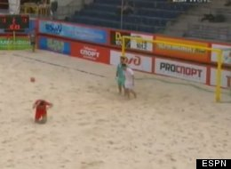 England's Matthew Evans kicks a ball in frustration that hits a Belarus player in the head during a beach soccer match.