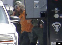 An alleged hoarder is in custody Friday after an hours-long standoff with police.