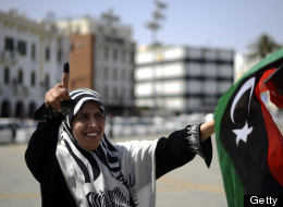 A Libyan woman celebrates in Martyrs' Square in Tripoli after voting for the Libyan General National Assembly on July 7, 2012. ( AFP PHOTO/GIANLUIGI GUERCIA)