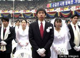 Some 60,000 Unification Church members took part in a mass wedding ceremony at the Chamsil Olympic Stadium in Seoul on Feb. 13, 2000.