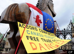 Civil Society Critics of CETA, the Canada-EU free trade deal, deliver a Trojan horse to Parliament Hill in Ottawa on Monday, October 17, 2011. (THE CANADIAN PRESS/Sean Kilpatrick)