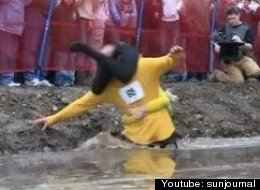 Sometimes you just want to haul your wife to victory. (From 2009 North American Wife Carrying Championship.)
