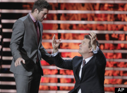 Tim Tebow corrects Alec Baldwin on his Tebowing form during the NFL Honors show Saturday, Feb. 4, 2012, in Indianapolis.