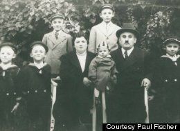 Matyas Fischer with his wife and six sons in their backyard in Serbia (then in Yugoslavia) around 1938. The youngest child is Paul Fischer, the lead plaintiff in a lawsuit against several European banks.
