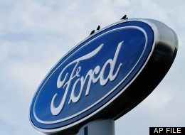 In this July 24, 2011 file photo, the Ford logo is displayed at an auto dealership in Springfield, Ill. (AP Photo/Seth Perlman, File)