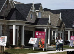 The Canadian Real Estate Association says there were fewer sales of previously owned homes last month, down 1.3 per cent from May and down 4.4 per cent from June 2011. (CP)