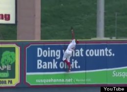 Jiwan James scales the wall to make an impressive catch during a minor league baseball game against the Bowie Baysox.