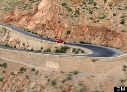 The Cadillac ATS drives on a road with about 100 hairpin turns in Morocco.