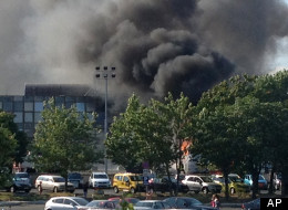 Smoke rises into the sky after an explosion at Burgas airport, outside the Black Sea city of Burgas, Bulgaria, some 400 kilometers (250 miles) east of the capital, Sofia, Wednesday, July 18, 2012. (AP Photo/ Burgasinfo)