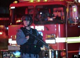 Un policier monte la garde à la suite de la fusillade à Toronto.
