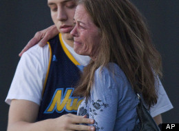 Jacob Stevens, 18, hugs his mother Tammi Stevens after being interview by police outside Gateway High School where witness were brought for questioning after a shooting at a movie theater, Friday, July 20, 2012 in Denver. A gunman wearing a gas mask set off an unknown gas and fired into a crowded movie theater at a midnight opening of the Batman movie