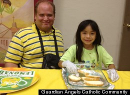 Zach Grossman and his daughter volunteering at I-HELP on July 19, 2012. Photo courtesy of Guardian Angels Catholic Community