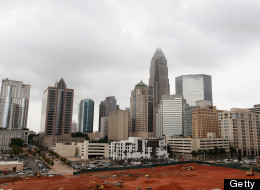 CHARLOTTE, NC - JULY 11: The Bank of America Corporate Center building, which houses the corporate headquarters for Bank of America, rises above the Charlotte skyline on July 11, 2012 in Charlotte, North Carolina.