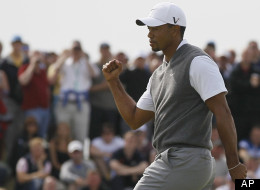 Tiger Woods reacts after putting on the sixth green at Royal Lytham & St Annes golf club during the third round of the British Open, July 21, 2012.