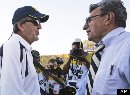 In this Sept. 22, 2007 file photo, Michigan coach Lloyd Carr, left, shakes hands with Penn State coach Joe Paterno, right, after the Wolverines won 14-9 in an NCAA college football game in Ann Arbor, Mich. (AP Photo/Tony Ding, File)