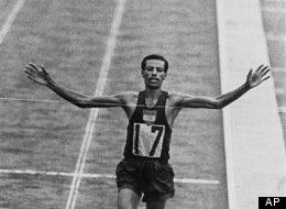 Abebe Bikila wins the Olympic marathon in Tokyo in 1964.