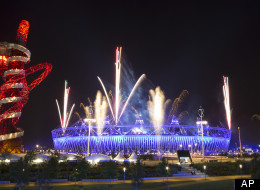 Fireworks explode over the Olympic Stadium during a rehearsal for the opening ceremony at the 2012 Summer Olympics, Wednesday, July 25, 2012, in London.