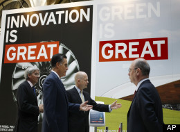 Republican presidential candidate and former Massachusetts Gov. Mitt Romney, second left, tours the GREAT Pavillion Exhibit with British Foreign Secretary William Hague in London, Thursday, July 26, 2012.