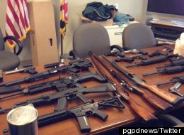 Police displayed some of the weapons seized from the suspect in an alleged shooting plot in Maryland.