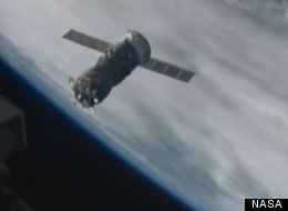 Russian caro spacecraft approaches International Space Station before successful docking.