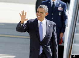 President Barack Obama arrives at John F. Kennedy International Airport, July 30, in New York. (AP Photo/Jason DeCrow)