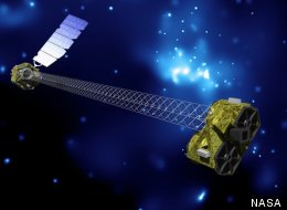 Artist's concept of NuSTAR in orbit. NuSTAR has two identical optics modules in order to increase sensitivity. The background is an image of the galactic center obtained with the Chandra X-ray Observatory.