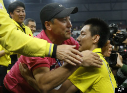 China's Chen Jin, right, is congratulated by head coach Li Yongbo after defeating Malaysia's Wong Choong Han during their semifinal match of the Thomas Cup badminton championships in Kuala Lumpur, Malaysia, Friday, May 14, 2010. (AP Photo/Lai Seng Sin)
