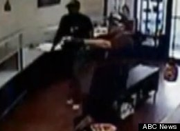 Two armed men posing as police attempted robbery at Marcelo Suarez's jewelry store in Tampa, Fla., Monday.
