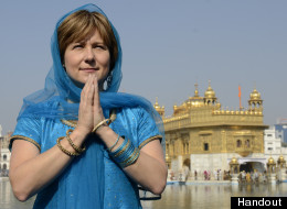 B.C. Premier Christy Clark is facing criticism from the B.C. Humanist Association, a prominent atheist group, over comments about being guided by the bible she made on an evangelical Christian talk show. Clark is seen here in India at the Golden Temple in Amritsar, a sacred site for Sikhs. (Handout)