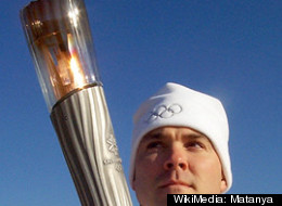 An actual Olympic torch at the 2002 games in Salt Lake City. Mitt Romney doled out a commemorative version now selling on eBay for hundreds, or thousands of dollars.
