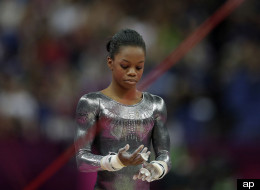 U.S. gymnast Gabrielle Douglas reacts after her performance on the uneven bars during the artistic gymnastics women's apparatus finals at the 2012 Summer Olympics, Monday, Aug. 6, 2012, in London.