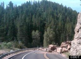 Giant boulders fall onto Highway 119, closing the road from Sugarloaf to Nederland in Boulder Canyon while crews remove rocks.