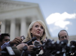 Arizona Gov. Jan Brewer speaks to reporters after the Supreme Court questioned Arizona's