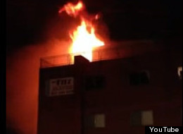 Flames visible from a fire that broke in the Fitz Apartment building in Aurora, Colo., near University of Colorado-Denver's Anschutz Medical Campus.