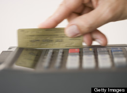 U.S. consumers cut back on credit card use in June, proving that more people are being cautious about spending.