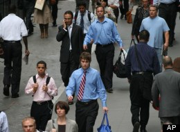 In this Sept. 30, 2008 file photo, people walk to work on Wall St., in New York. (AP Photo/Mark Lennihan, file)